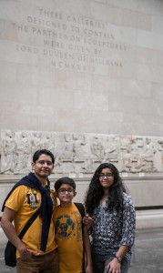 Family in front of frieze