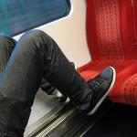 Feet on train seat