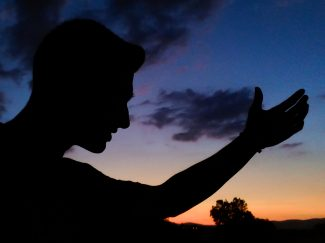 Silhouette of person gesturing